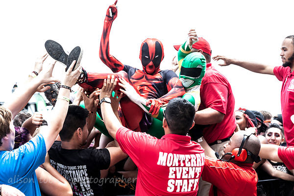 Superhero crowd surfers