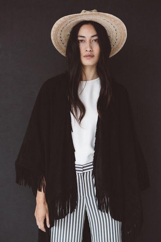Le Fashion Blog Jenni Kayne Resort 2016 Black Fringe Cape Straw Hat White Top Striped Pants Via Style Com