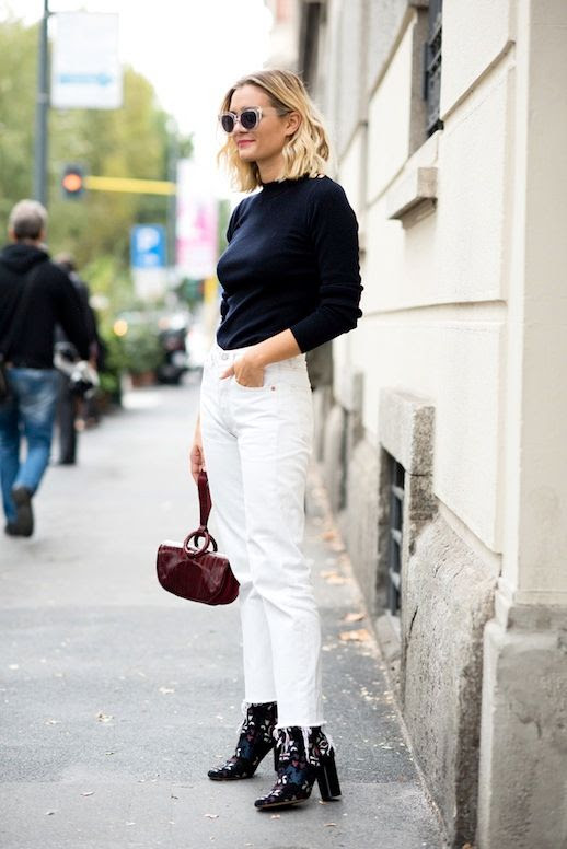Le Fashion Blog Winter Street Style Black Sweater Burgundy Wristlet White Boyfriend Vintage Jeans Isabel Marant Suede Embroidered Ankle Boots Via Adenorah