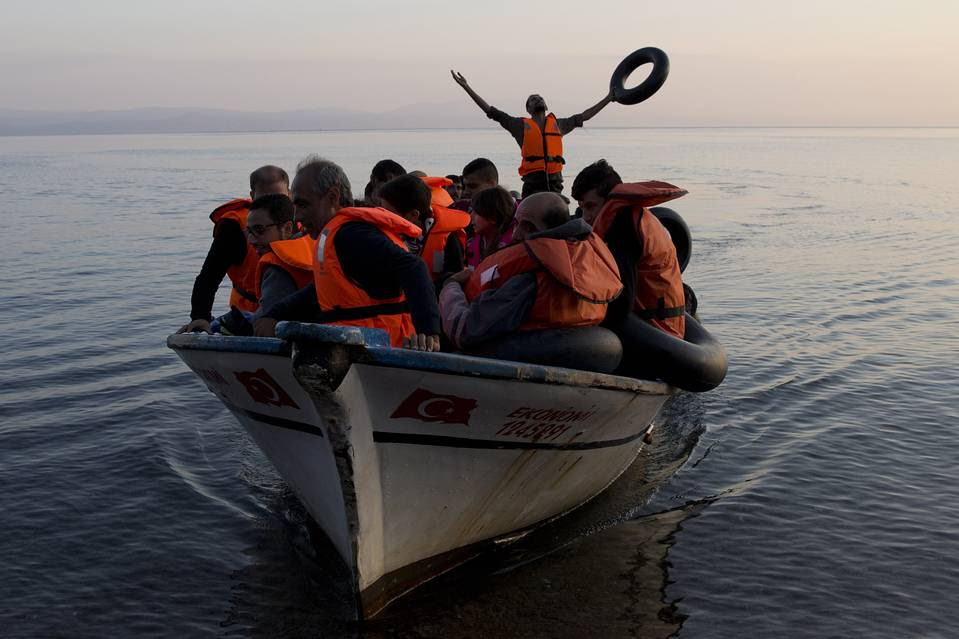Syrian refugees arrive from Turkey and land on the Greek island of Lesbos in September. The cost to Greece could rise further if many migrants end up stuck in the country because of Balkan border closures.