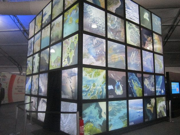 """Waters of the Planet,"" an installation of the Museum of Tomorrow in Rio de Janeiro, exhibited in the Citizen's Village at the 8th Water Forum, held in the capital of Brazil, is a large cube with satellite photos showing the Earth's seas, rivers and lakes from space. Credit: Mario Osava / IPS"