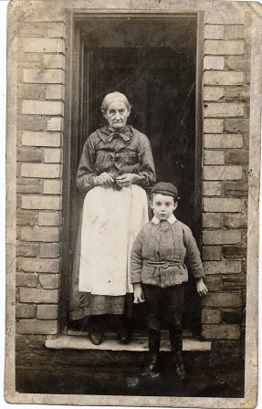 Woman and boy standing on doorstep