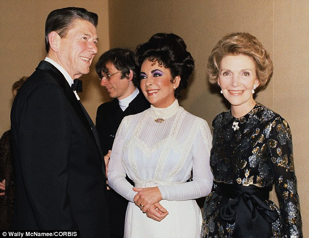 Three's a crowd: Elizabeth Taylor, centre, with Ronald and Nancy Reagan, discuss the play The Little Foxes, in which the actress starred, in March 1981