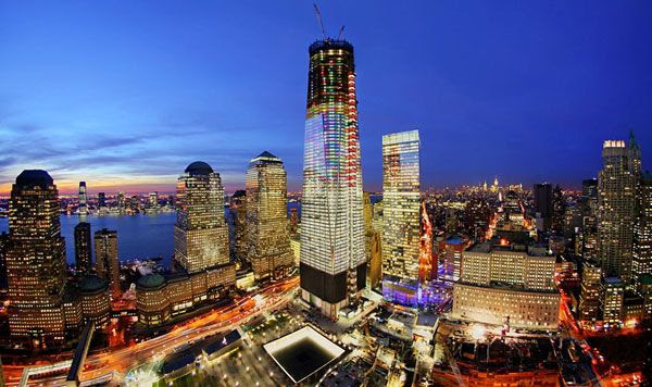 Dusk falls upon the 1 World Trade Center and the rest of Manhattan in December of 2011.
