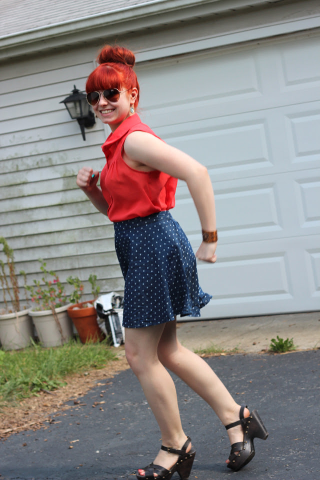 jogging in clog sandals, aviators, and a denim skirt