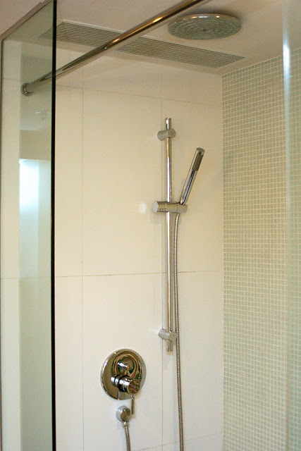There's no bathtub, but you get your overhead rain shower