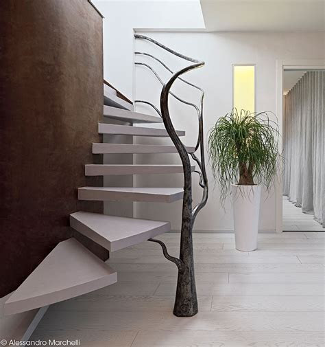 A Tree Like Sculpture Railing for This Staircase