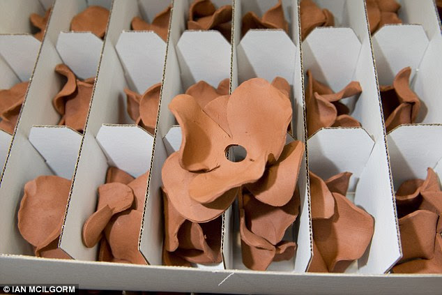 The fired flowers are then boxed before being sent to another facility to be glazed bright red