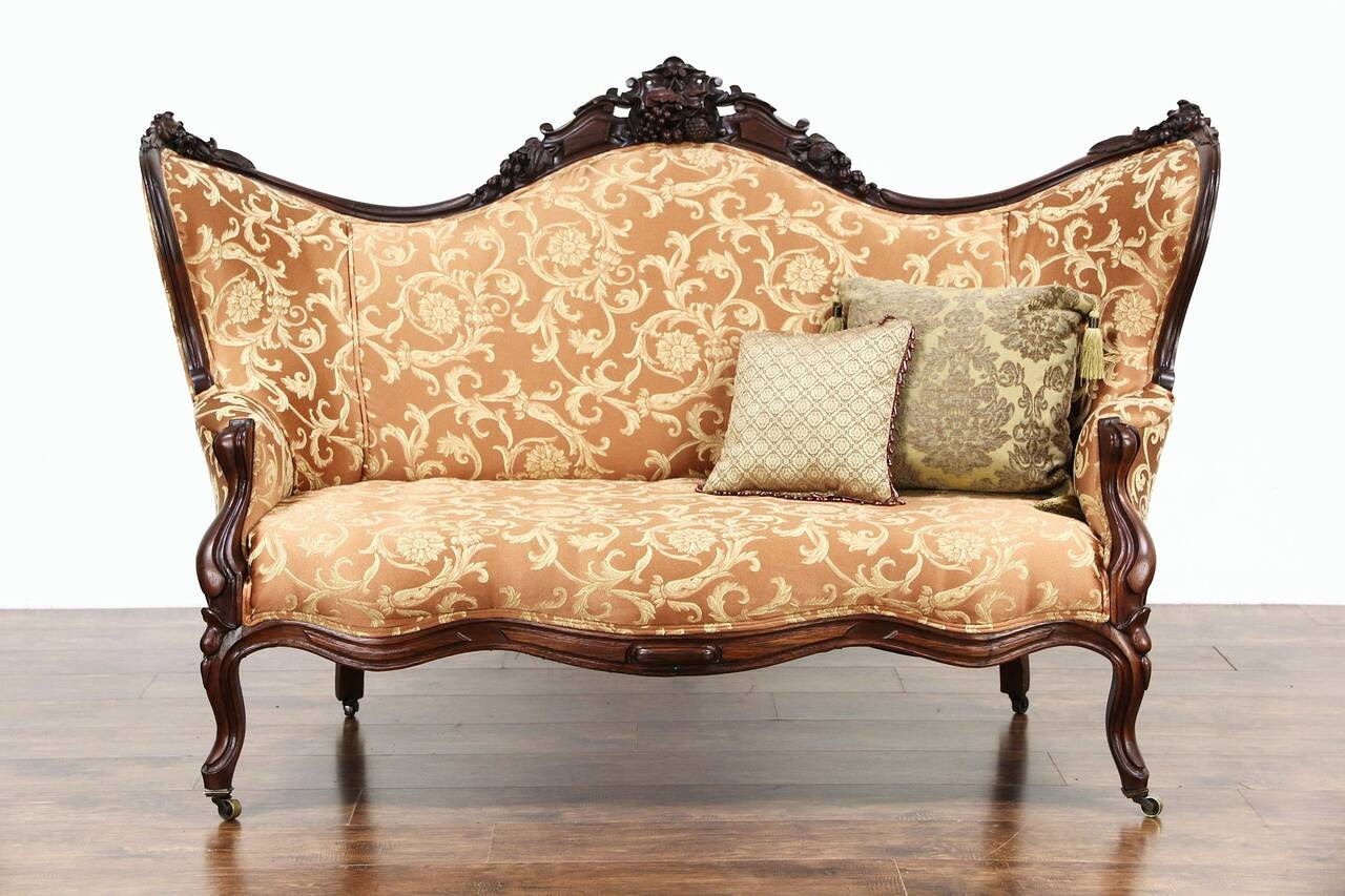 american made antique furniture, brass wheels are original.
