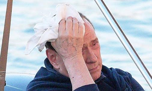 Silvio Berlusconi bumps his head boarding his yacht in St Tropez