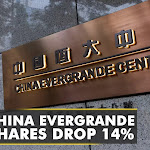 Shares of China Evergrande group slid as much as 14%