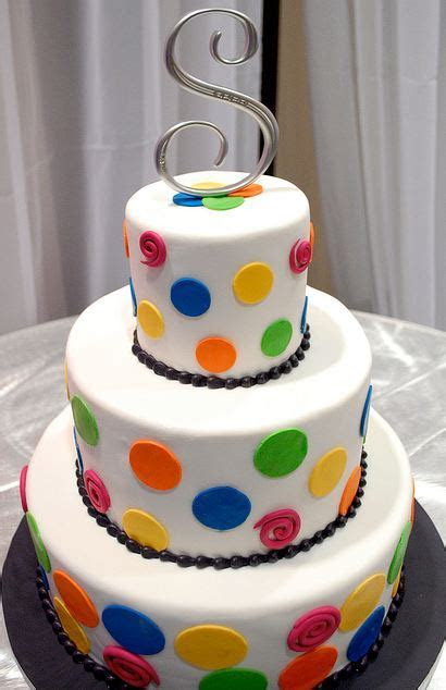 3 level white round wedding cake with pokadots and silver