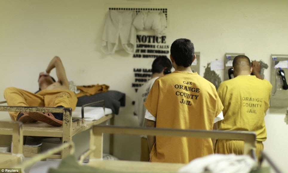 One inmate is forced to sleep next to phones where fellow prisoners make phone calls home at the Orange County jail