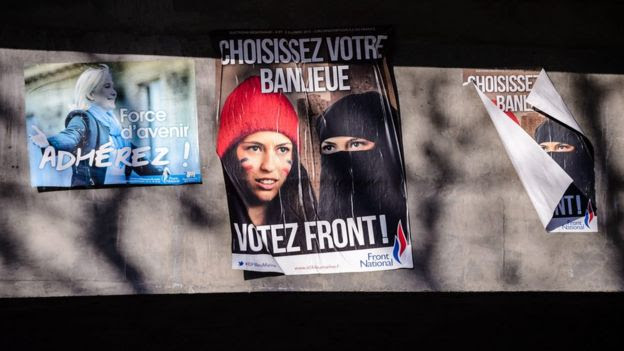 An election campaign poster (C) for French far-right Front National (FN) party reads