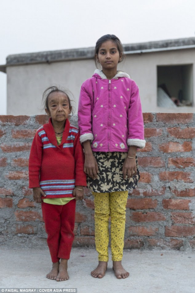 Siblings: Anjali Kumari, 7, poses for a picture with her sister Shilpi Kumari, 11, at their home in Ranchi, India