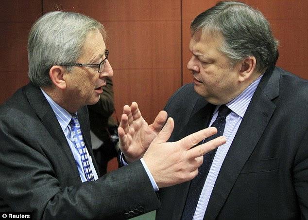 Deal: Ελλάδα Οικονομικών ο υπουργός Ευάγγελος Βενιζέλος (δεξιά) συνομιλεί με τον Πρωθυπουργό του Λουξεμβούργου και υπουργός πρόεδρος της Ευρωομάδας, Ζαν-Κλοντ Γιούνκερ κατά την έναρξη των συνομιλιών να συμφωνήσουν σε ένα νέο γύρο μέτρων λιτότητας για τις υπερχρεωμένες χώρες