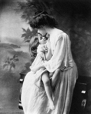 Mother holding girl.