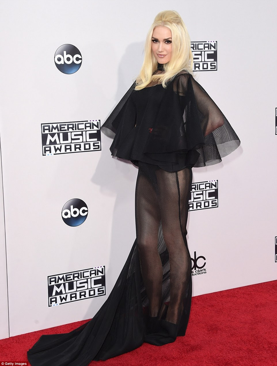 Attention grabbing: Gwen Stefani made quite a statement in a sheer black gown with dramatic ruffles