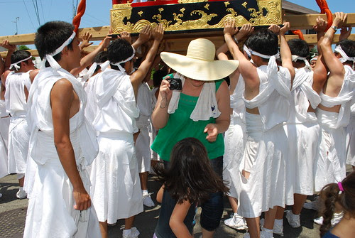 emerging from under the mikoshi