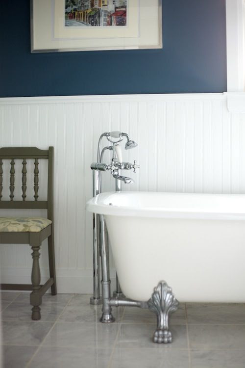 this color scheme: grey tile, blue walls with white beadboard Paint color is Observatory by Behr