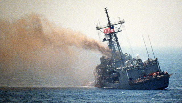 U.S.S. Stark listing after being struck by two Exocet missiles fired by Mirage F-1 jet fighter of Saddam Hussein's (1987-05-17; Wikipedia)