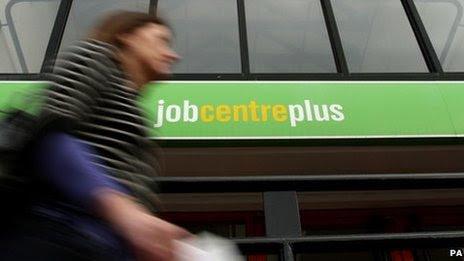 Woman walks past job centre