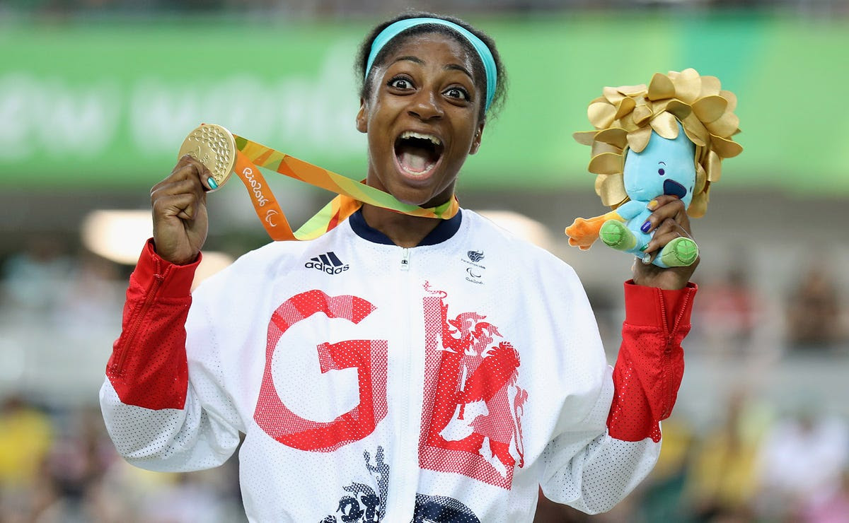 Kadeena Cox celebrates her gold medal in cycling.