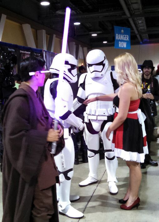 A Jedi cosplayer welding Mace Windu's lightsaber wonders if he needs to neutralize those First Order Stormtroopers in order to get that girl's digits...at Long Beach Comic Con on September 12, 2015.