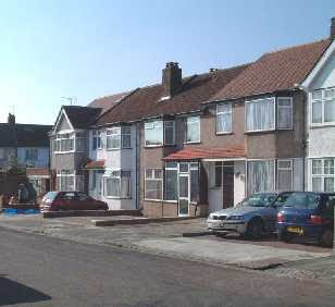 a series of paved front gardens
