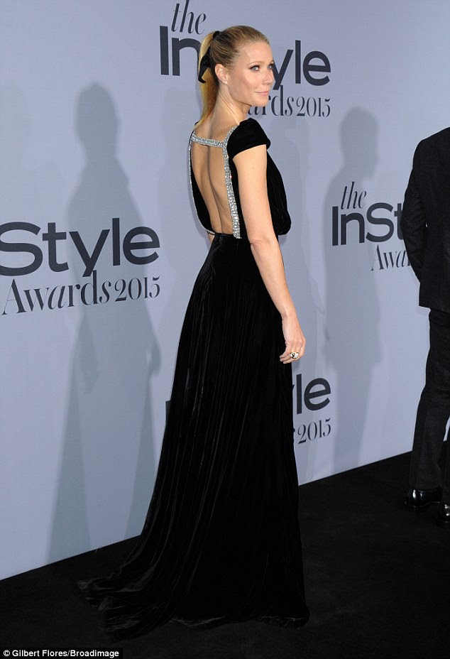 Just something I threw on: For Gwyneth it was a night to show off her classical side, in floor-length black velvet
