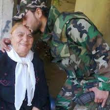 Syrian soldier kissing the head of old woman