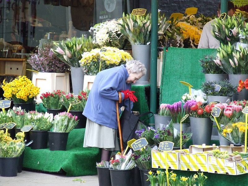 File:Old lady buying flowers.JPG