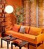 Orange living room // colorful living room interior designs