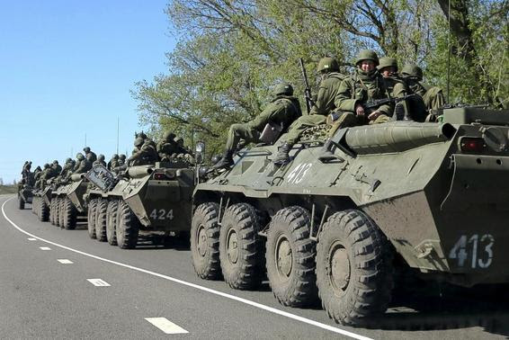 Russian servicemen drive armoured personnel carriers on the outskirts of the city of Belgorod near the Russian-Ukrainian border in this April 25, 2014 file photo. REUTERS-Alexander Mikhailov-Files