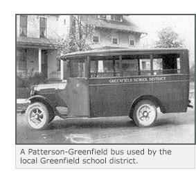 A Patterson-Greenfield bus printed with the words 'Greenfield School District'.