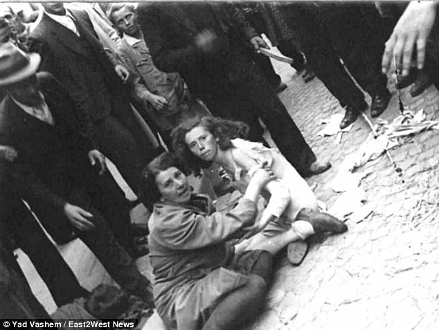 "Infanticide: The beating of Jewish women in the streets of Ukraine (pictured) was a regular occurrence and one witness told how a cruel Nazi grabbed a woman""s two-year-old child and beat its head against a wall"
