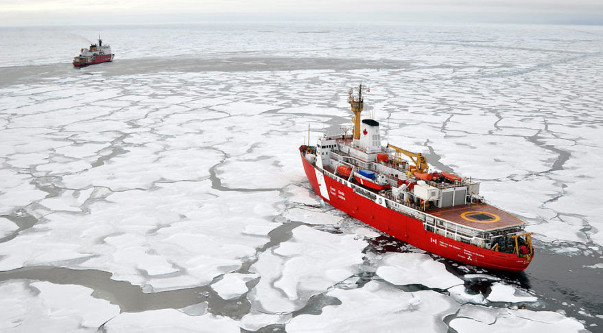 The Canadian Coast Guard Ship Louis S. St-Laurent makes an approach to the Coast Guard Cutter Healy in the Arctic Ocean. Credit: Patrick Kelley, U.S. Coast Guard