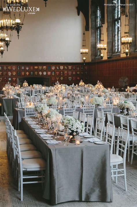 Family style reception with white chiavari chairs, gray