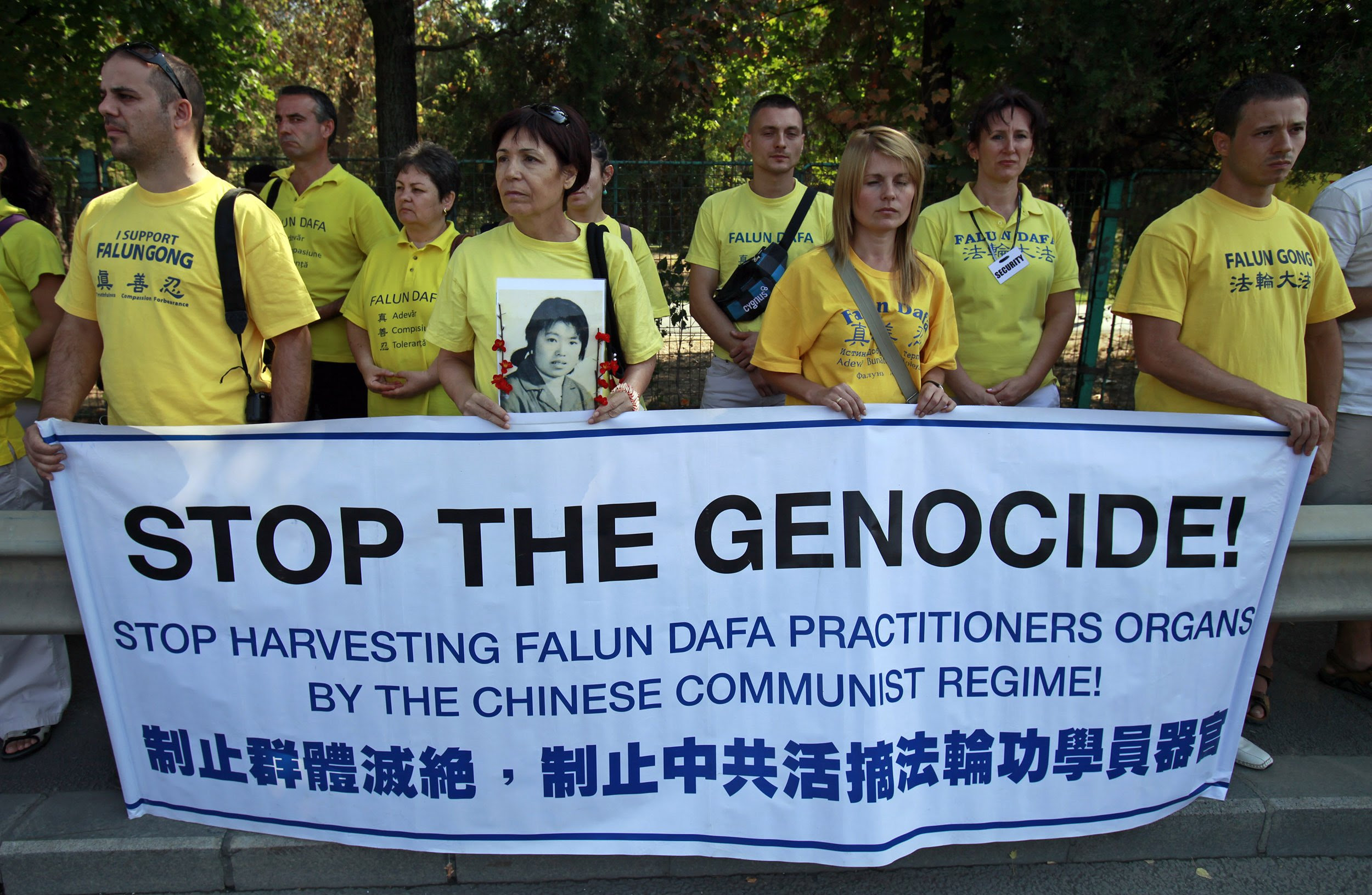 Falun Gong practitioners hold portraits of fellow Chinese practitioners as they protest against China's crackdown on Falun Gong followers in front of the Chinese embassy in Bucharest, Romania on September 24, 2011.
