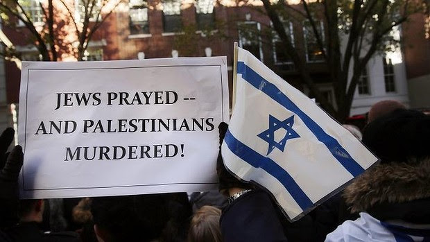 Pro-Israel protestors demonstrate in New York City following the death of four men who were reportedly killed by two armed Palestinians.