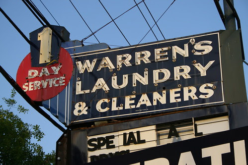 warren's laundry & cleaners neon sign