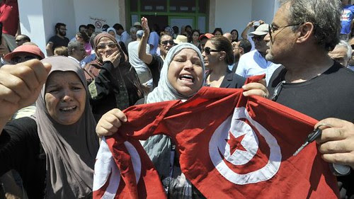 Tunisians protest after the assassination of Popular Party leader Mohamed Brahmi. Demonstrations have spread across the North African state. by Pan-African News Wire File Photos