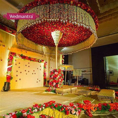 A grand stage decorated with a canopy of flowers. #