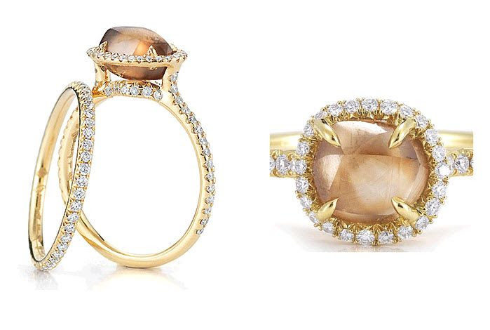 Pave set diamond and platinum engagement ring with rough diamond center