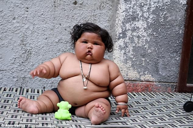 Chahat Kumar, eight months, from India, weighs a similar amount to that of a four-year-old