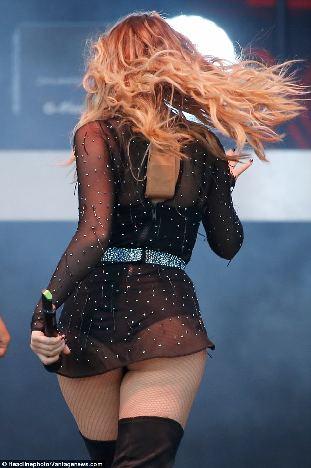 Bum deal: Perrie flaunted her pert posterior as she turned away from the crowd during her routine