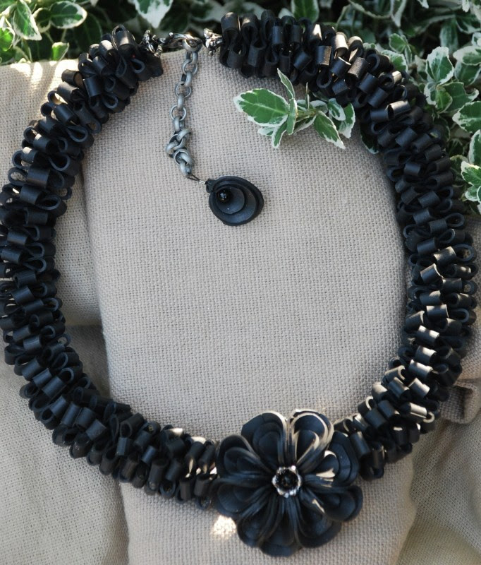 Necklace. All inner tube with the signature hand cut and hand stitched flower in the center.