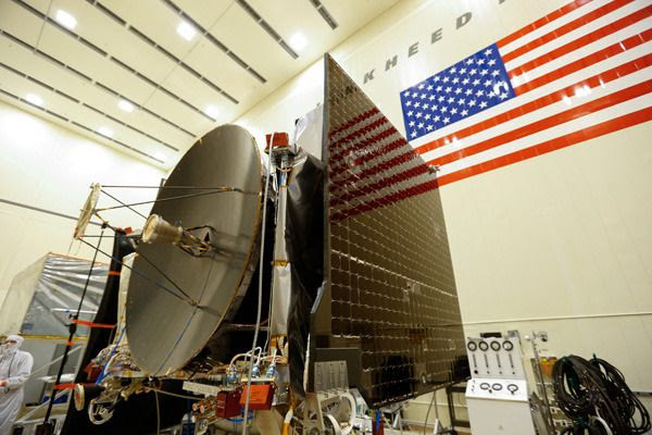 NASA's OSIRIS-REx spacecraft completes assembly after technicians install the probe's high-gain antenna and twin solar arrays...at the Lockheed Martin facility near Denver, Colorado.