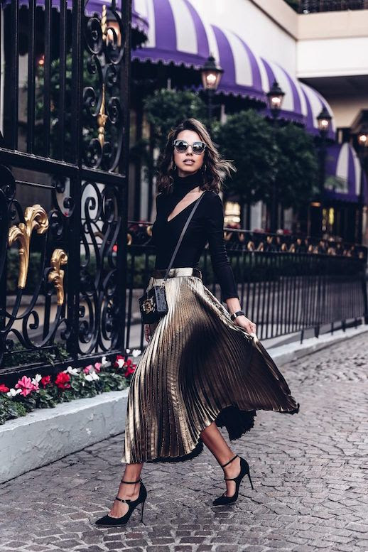 Le Fashion Blog Open Shoulder Black Top Gold Pleated Skirt Box Bag Black Pumps Via The Viva Luxury