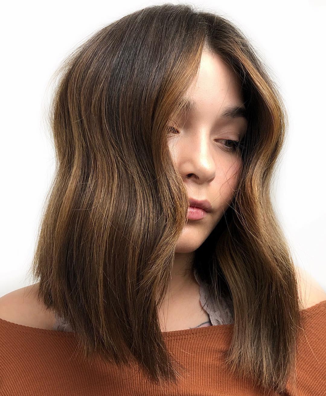 layered wavy hair low maintenance medium length hairstyles